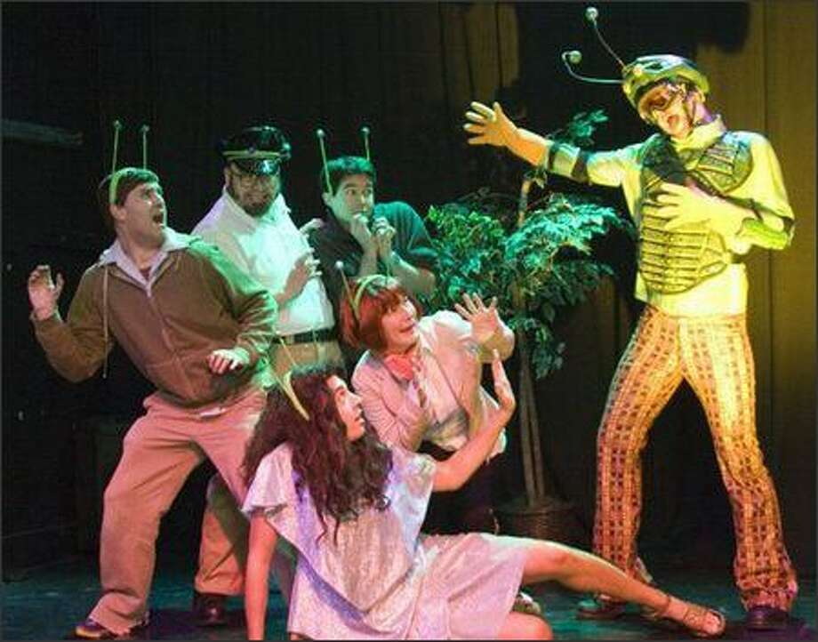 "The Locust King (Todd Hull, right) menaces the ""Exorcist: The Musical"" cast, from left, Josh Hartvigson, Ron Sandahl, Andy Justus, Retha Tinker and Joel Steinpreis (bottom of photo). Photo: K.P. Ramsdale"