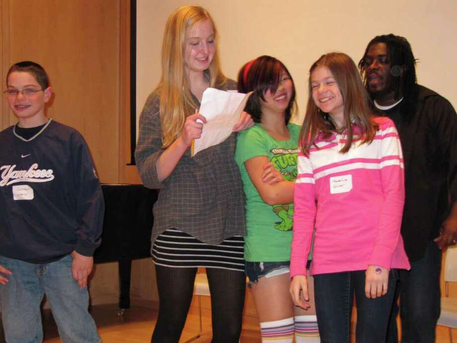 Regie Gibson, far right, rehearses with student performers, from left, Jackson Ward, Cressida Richards, Ali Kandiew and Madeline Driver, in preparation of the Wilton Library's fifth annual Poetry in Motion event. The teen's work can be seen Friday and Saturday, March 25 and 26, beginning at 7:30 each night. Receptions follow the performances. Photo: Contributed Photo / Stamford Advocate Contributed