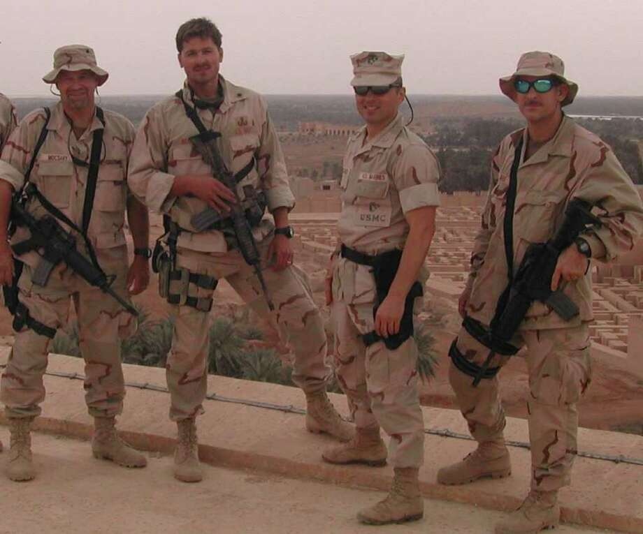 Marine Colonel Matthew Bogdanos, second from right, stands with members of his team, including, from left, Steve Mocsary, Dave Beckett and Bud Rogers, during a 2003 tour of duty in Iraq. The men were part of a concentrated effort to recover the artifacts and other treasures that had been looted from the Iraq Museum during the 2003 fall of Baghdad. Photo: Contributed Photo / Stamford Advocate Contributed