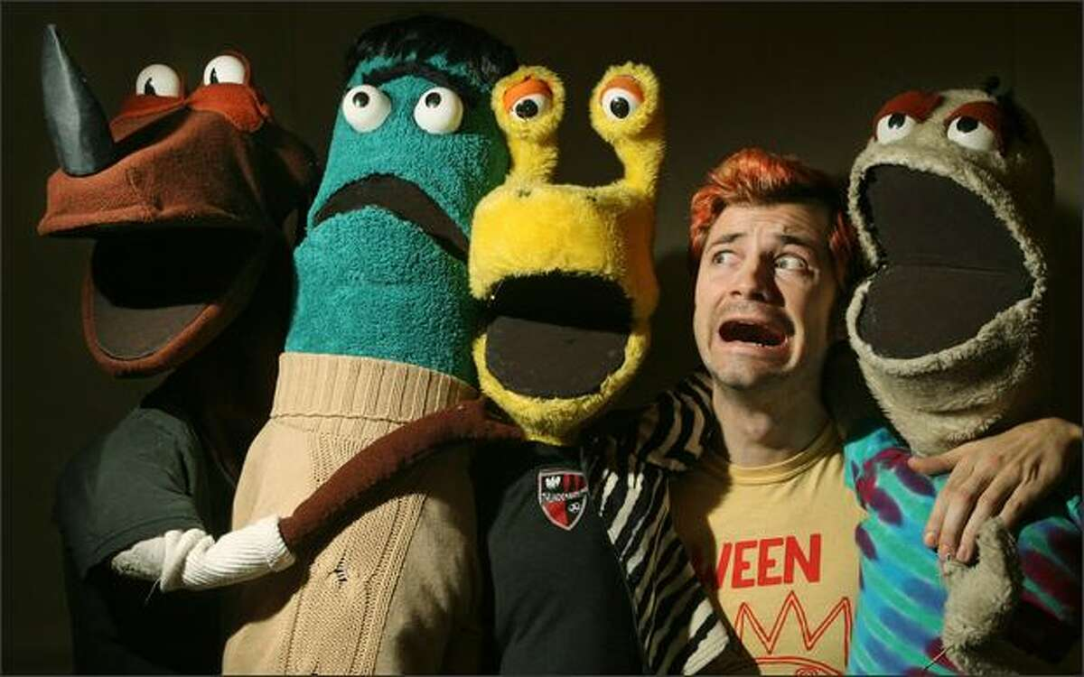 Puppeteer Stubby Abbot, who also sings in the band Guns That Shoot Knives, hams it up with some of his Space Losers puppets in his University District home.