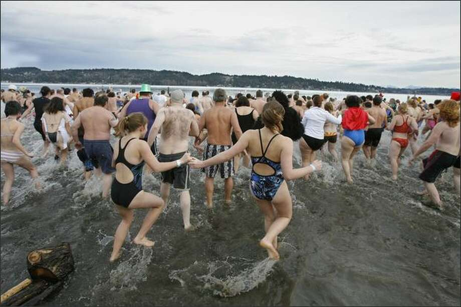 Swimmers head for the water during the Sixth Annual Polar Bear Plunge on Tuesday at Matthews Beach Park in Seattle. Photo: Gilbert W. Arias/Seattle Post-Intelligencer