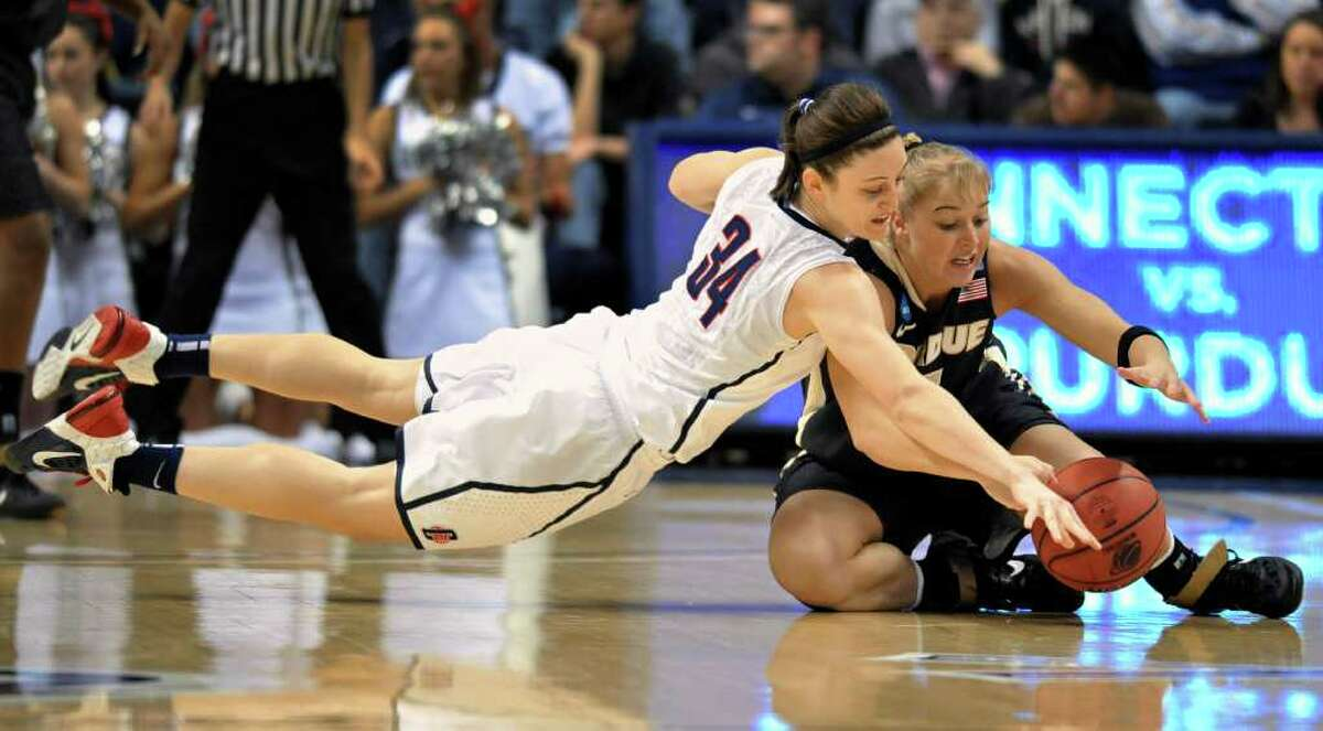 Connecticut's Kelly Faris, left, dives for the ball as Purdue's Brittany Rayburn, right, loses control of the ball during the first half of a second-round NCAA women's college tournament basketball game, Tuesday, March 22, 2011, in Storrs, Conn. (AP Photo/Jessica Hill)