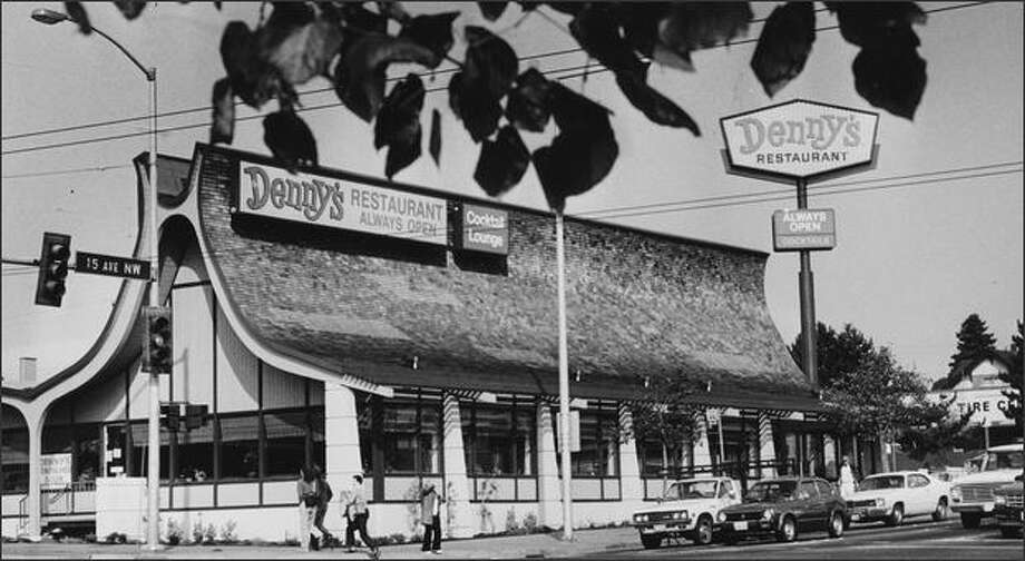 "The restaurant at 15th Avenue Northwest and Northwest Market Street in Ballard was built in 1964 as Manning's Cafeteria. An example of ""Googie"" architecture, it is shown here the day after reopening as a Denny's in 1984. Photo: Phil H. Webber/P-I File/1984"