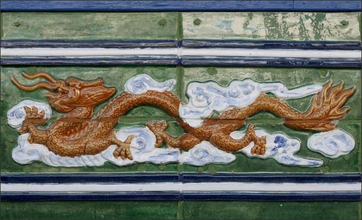 A dragon is featured in the tile work on the new Chinatown gate, which will be unveiled Feb. 9.