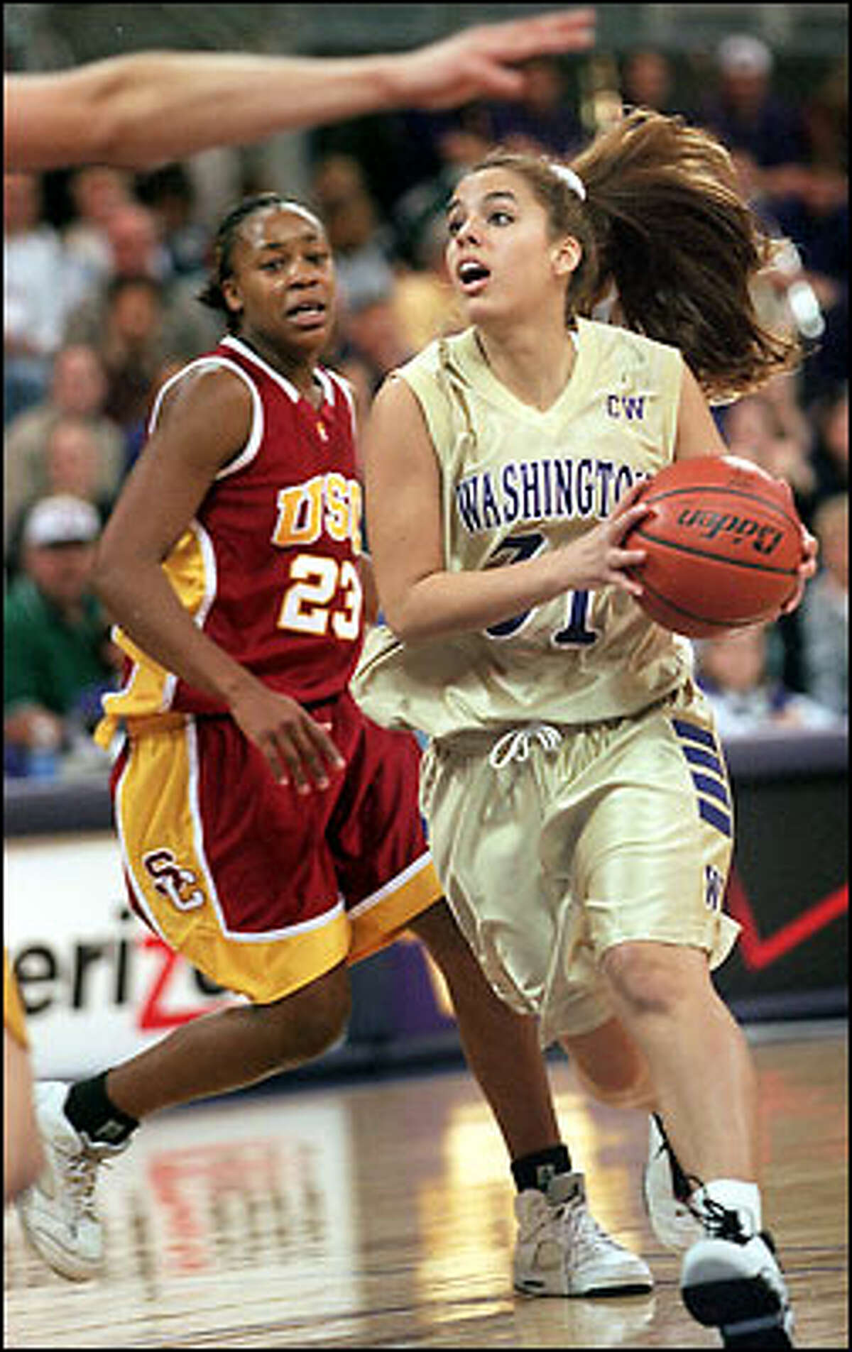 Gioconda Mendiola drives past USC's Aisha Hollins.