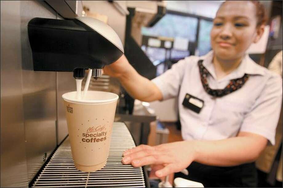 McDonald's restaurants already have started adding coffee bars with baristas. Here, Miriam Ventrua mixes a vanilla latte Monday at the Tukwila McDonald's. Photo: Scott Eklund/Seattle Post-Intelligencer