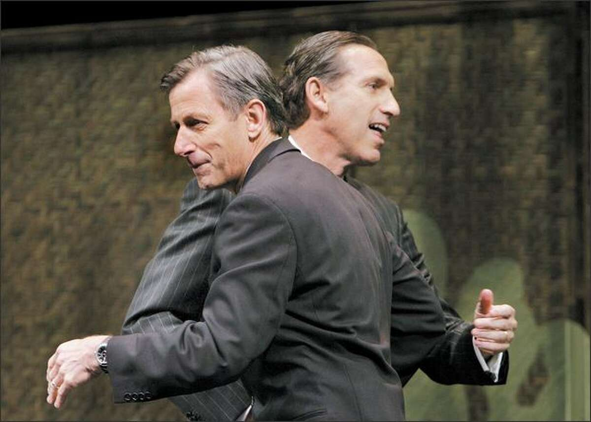 Starbucks Chairman Howard Schultz, right, pats CEO Jim Donald after introductions to shareholders in March.