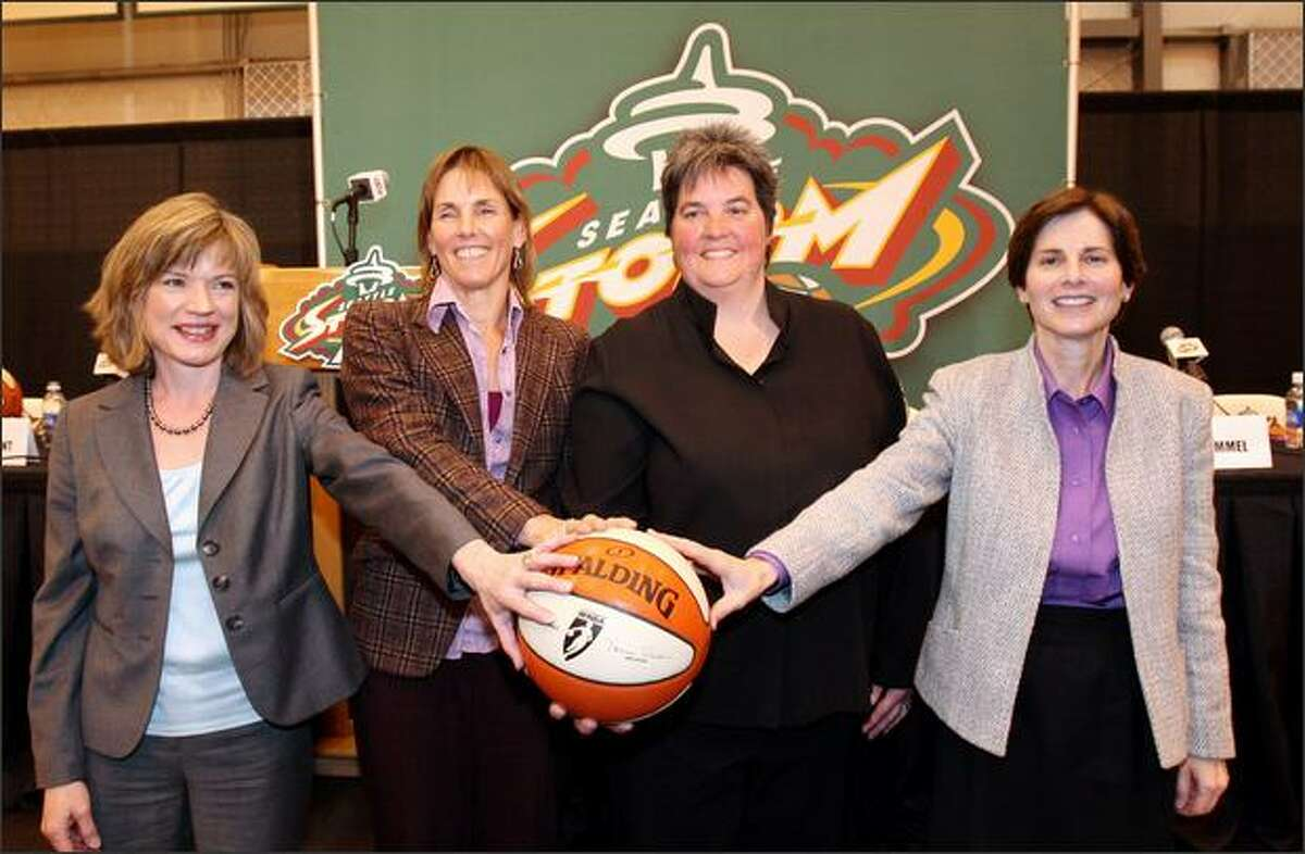 The group of women who are buying the Seattle Storm basketball team appear at a news conference on Tuesday. From left: Dawn Trudeau, Ginny Gilder, Lisa Brummel and Anne Levinson.