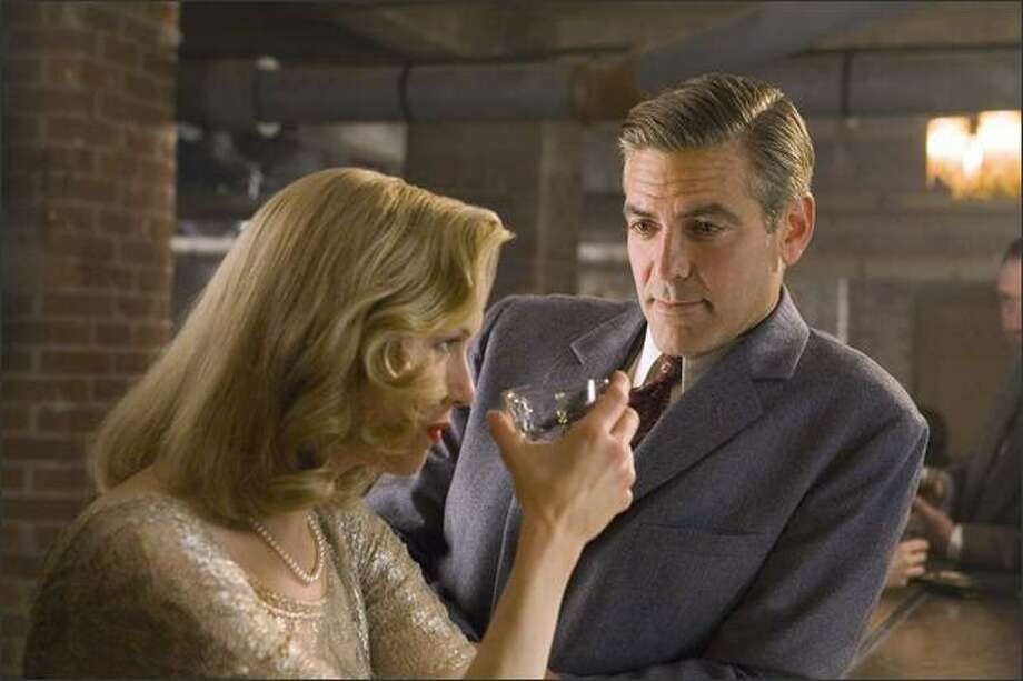 "Renée Zellweger and George Clooney in ""Leatherheads,"" a 1920s-era romantic comedy about pro football. Photo: /"