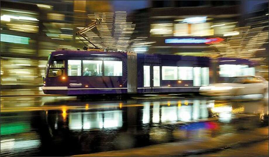 A northbound South Lake Union Streetcar travels north along Westlake Avenue North, near Denny Way, in Seattle on a rainy evening. Photo: Dan DeLong/Seattle Post-Intelligencer