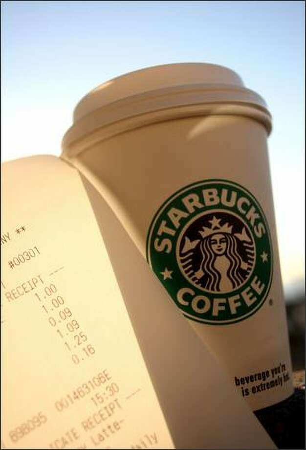 A cup of coffee purchased for $1 plus tax at the Starbucks at Pike Place Market in Seattle. Photo: Mike Kane/P-I