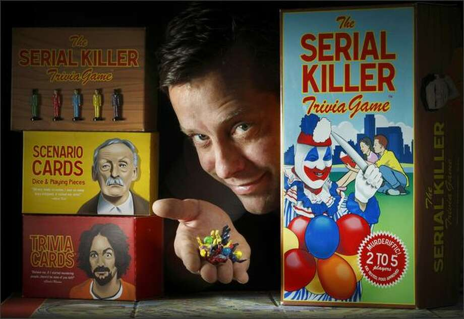 Children's book illustrator Ryan Hobson has spent the past three years developing a board game called Serial Killer. A prototype is at Capitol Hill's Vermillion Gallery. Photo: Andy Rogers/Seattle Post-Intelligencer