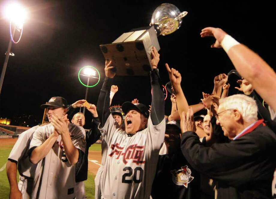 In the center, team manager, No. 20, Jim Pankovits, holds up the Penn League Championship Trophey, with his players as the Tri-City ValleyCats celebrate on the field after defeating the Brooklyn Cyclones in game two of the best of three New York-Penn League Championship Series, at MCU Park, on Tuesday, Sept. 14, 2010, in Brooklyn NY.   Game two was postponed twice due to rain storms in New York City.  Photos for daily sports coverage, with game story, for Mark Maguire column & blog and for web photo gallery.     (Luanne M. Ferris / Times Union ) Photo: Luanne M. Ferris / 00010225A