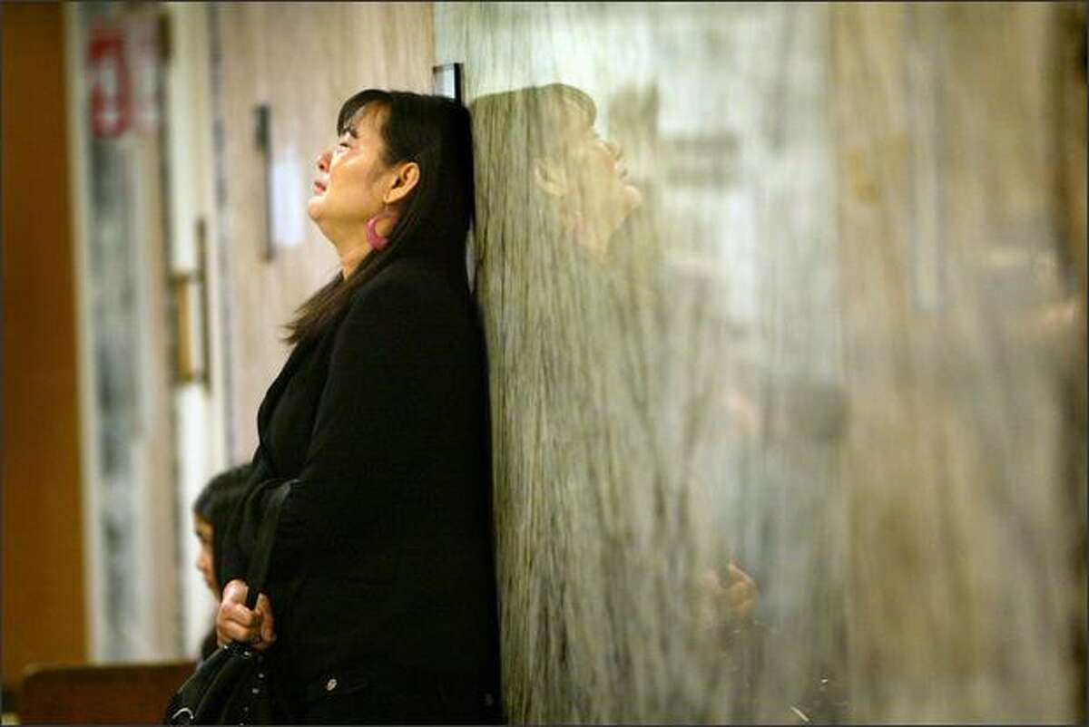 Savoeun Keo, mother of Sophea Sun, who was killed by Dimitri Sidorchuk, grieves in the courthouse hallway as Sidorchuk is sentenced Thursday.