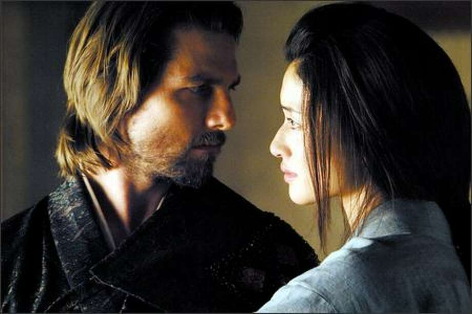 "Ton Cruise and Koyuki star in the epic action drama ""The Last Samurai,"" which opens Friday. Photo: Warner Brothers"