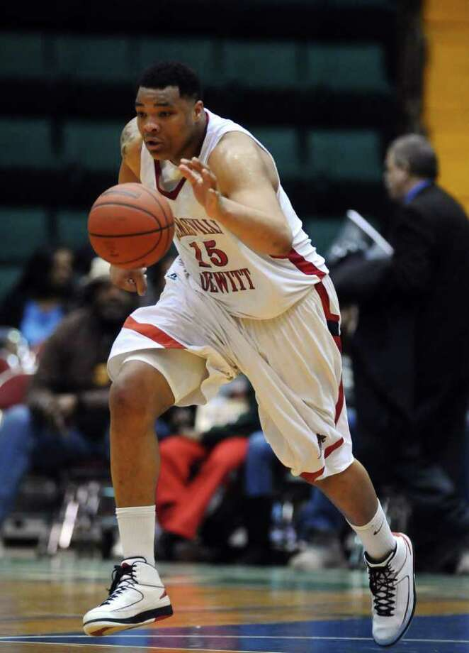 Jamesville-DeWitt's Dajuan Coleman brings the ball upcourt during the second half of their win over Harborfields in the Class A final of the New York State Public High School Athletic Association tournament at the Glens Falls Civic Center on Sunday March 20, 2011 in Glens Falls, NY.  ( Philip Kamrass/ Times Union ) Photo: Philip Kamrass