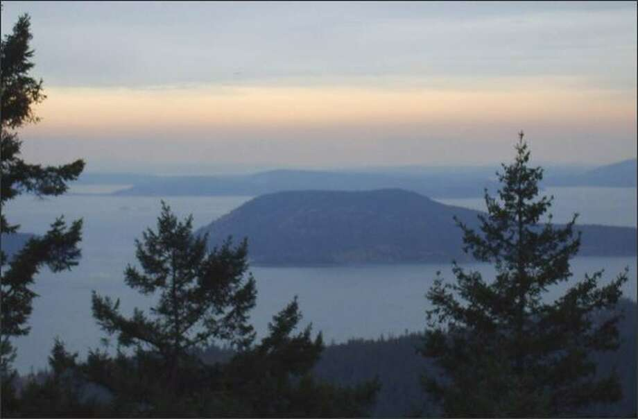 Parts of Washington's San Juan Islands are on a list of 18 areas the Obama administration has selected for new federal protection. Looking out from the top of Mount Erie, Fidalgo Island's highest point (1,273 feet), amazing views are seen of the San Juan Islands, including Decatur Island, Burrows Island, Washington Park and Cypress Island. Photo: Karen Sykes/Special To The Post-Intelligencer