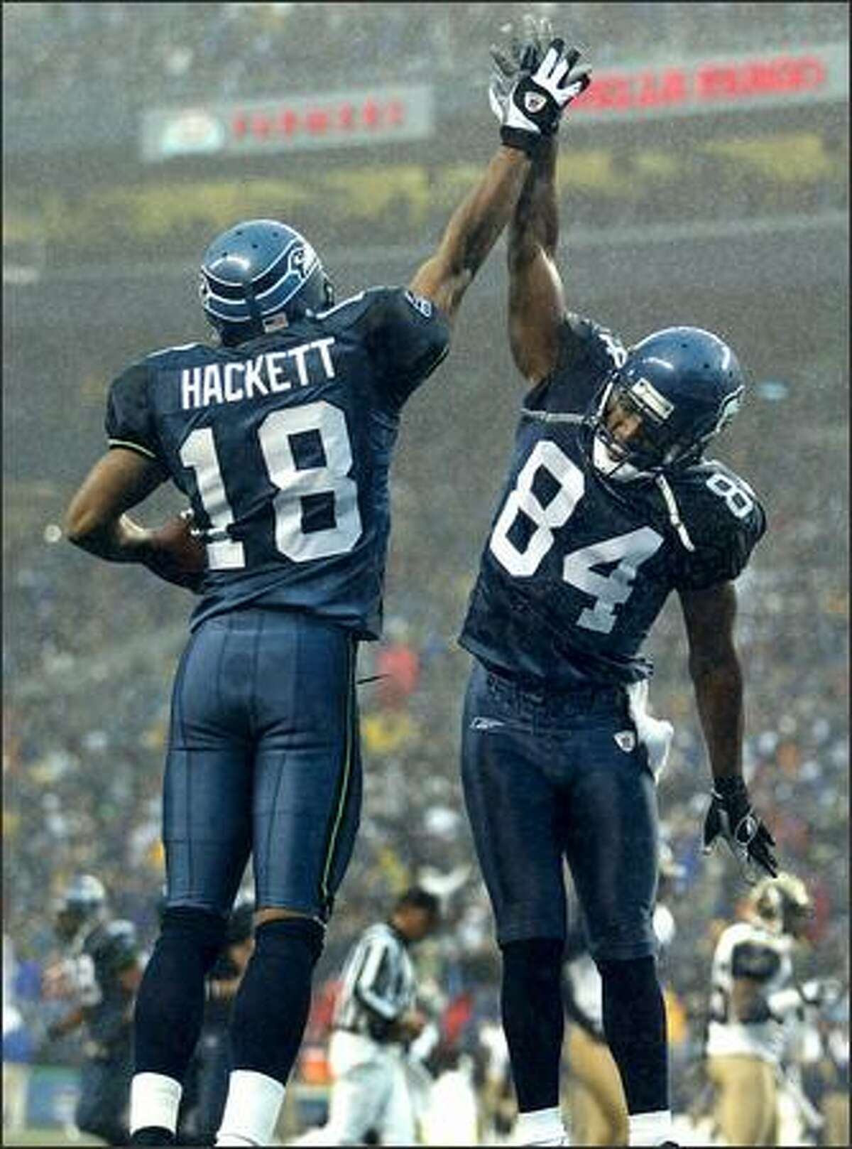 Seahawks' wide receivers Bobby Engram (right) and D.J. Hackett celebrate following Hackett's 31-yard touchdown reception in the third quarter.