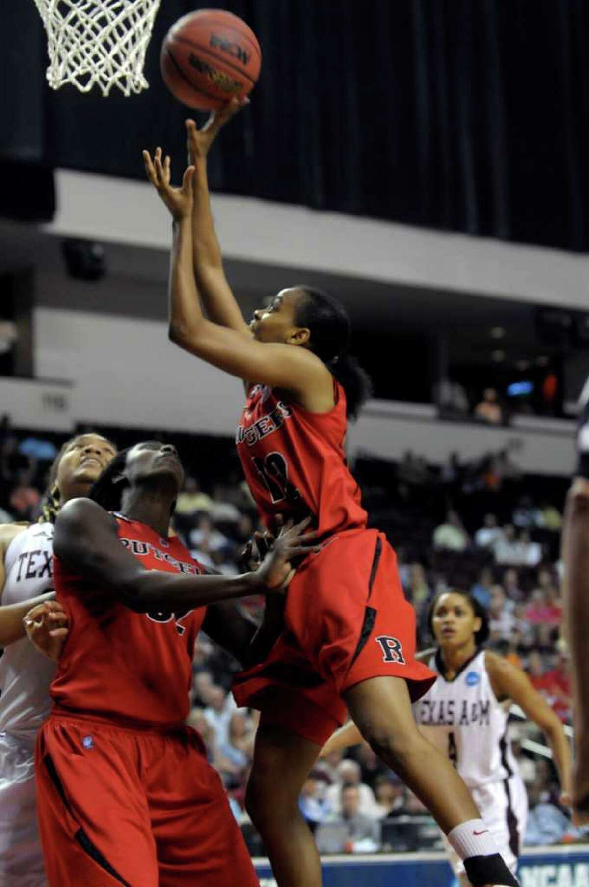 Rutgers guard Daisha Simmons (12) shoots over the Texas A&M defense during the first half of a second-round game of the NCAA women's college basketball tournament, Tuesday, March 22, 2011, in Shreveport, La.