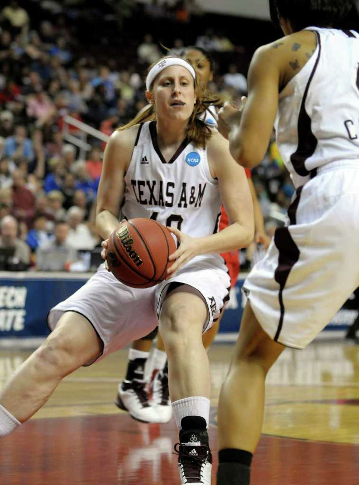 Texas A&M forward Kelsey Assarian (40) looks for a teammate after pulling down a rebound against Rutgers during the first half of a second-round game of the NCAA women's college basketball tournament on Tuesday, March 22, 2011, in Shreveport, La.