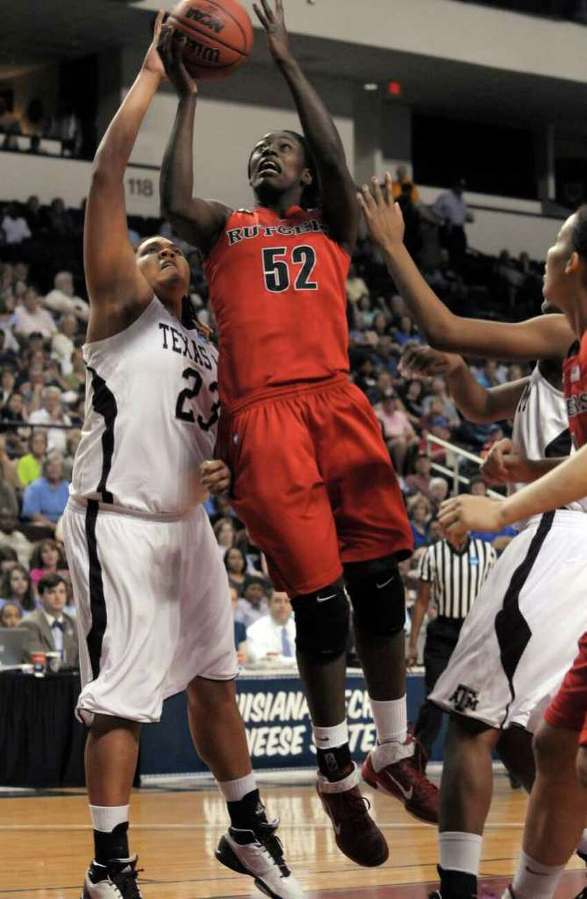 Rutgers forward Chelsey Lee (52) puts a shot up over Texas A&M forward Danielle Adams (23) during the first half of a second-round game of the NCAA women's college basketball tournament in Shreveport, La., on Tuesday, March 22, 2011.
