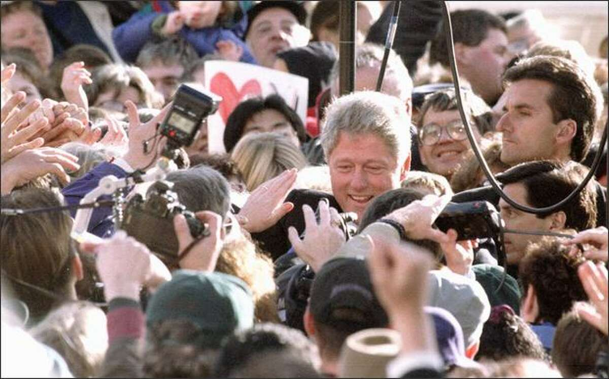 Bill Clinton came back to the Northwest 13 times during his presidency. He used Blake Island and the University of British Columbia for Asia-Pacific summitry, helped push a government van out of the mud, and gave gray hairs to Secret Service agents by finding unsecured rope lines after giant Pike Place Market rallies.
