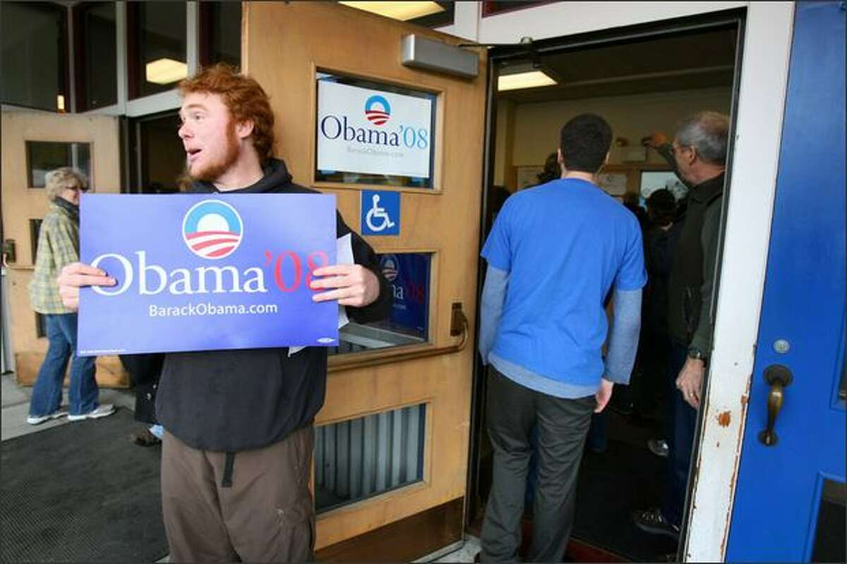 Chris McMillan, who told the precinct captain that he was a registered Republican, campaigns for Barack Obama during a Democratic caucus at Olympic Hills Elementary School.