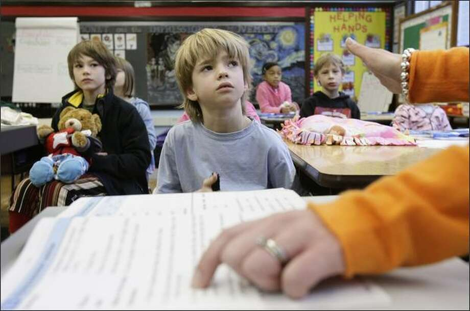 Second-graders Costa Colachis Glass, left, Peter Springer, Aniya Beck and Vitaly Repkov listen to teacher Heather Christothoulou at McGilvra Elementary in Seattle. Her class has 20 children, while other schools may have up to 30 in a class. Photo: Andy Rogers/Seattle Post-Intelligencer