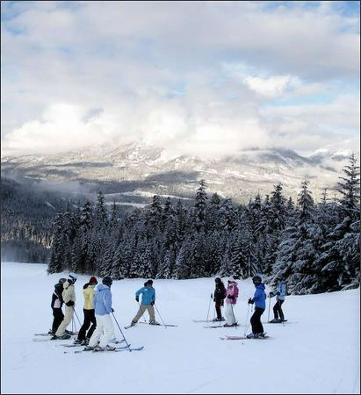 Roxy All-Star Ski Camp instructor Kylie Bertuch teaches a group of eight women at Whistler Blackcomb Ski Resort.