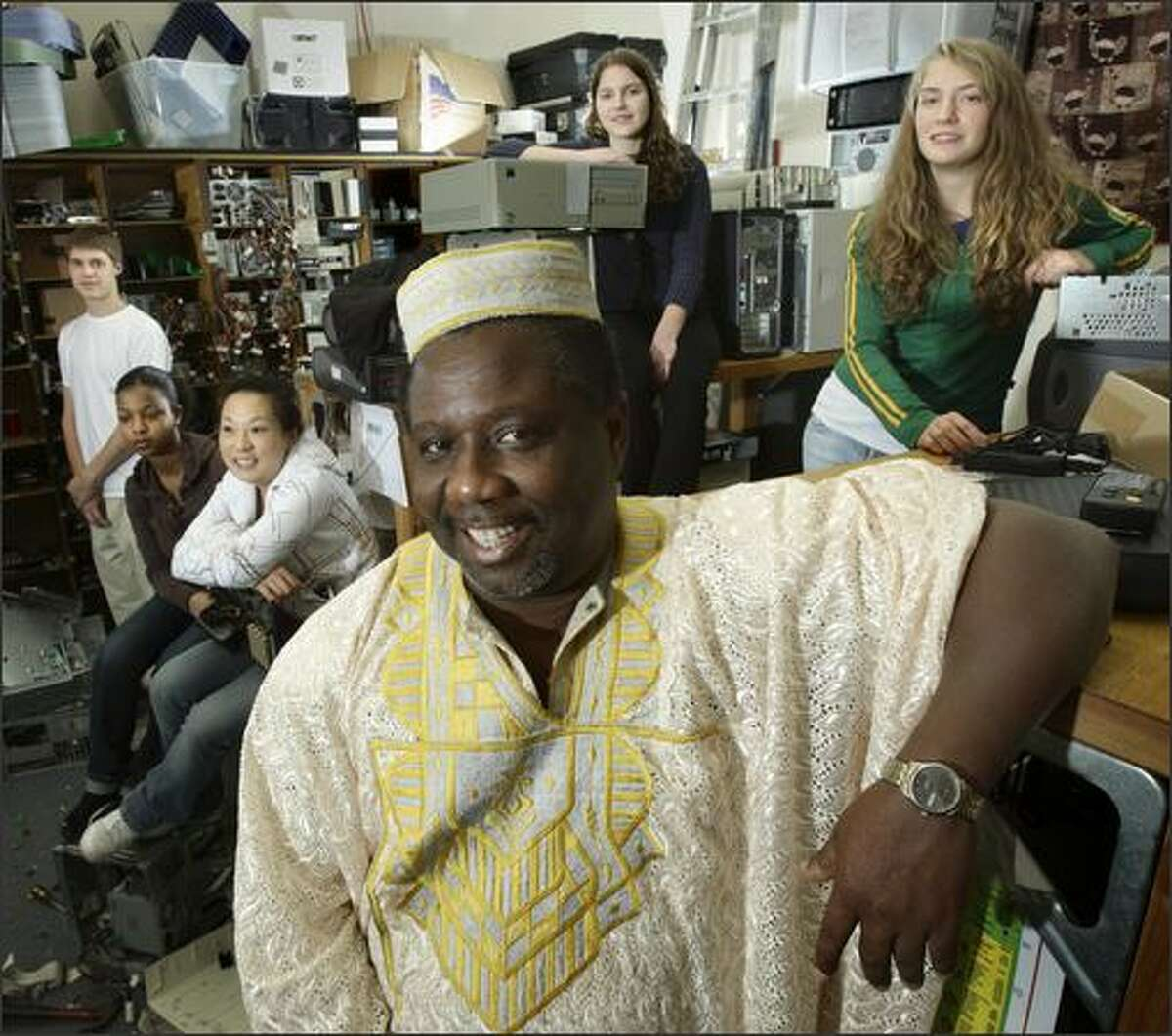 Samuel Labi, a Garfield High School counselor and chief of the Ghanaian village of Kyirenkum, will go to the West African nation next week with students including Kevin Marck, left, Dlena Teklai, Hanah Moriguchi, Caitlin Anderson and Miran McPoland.