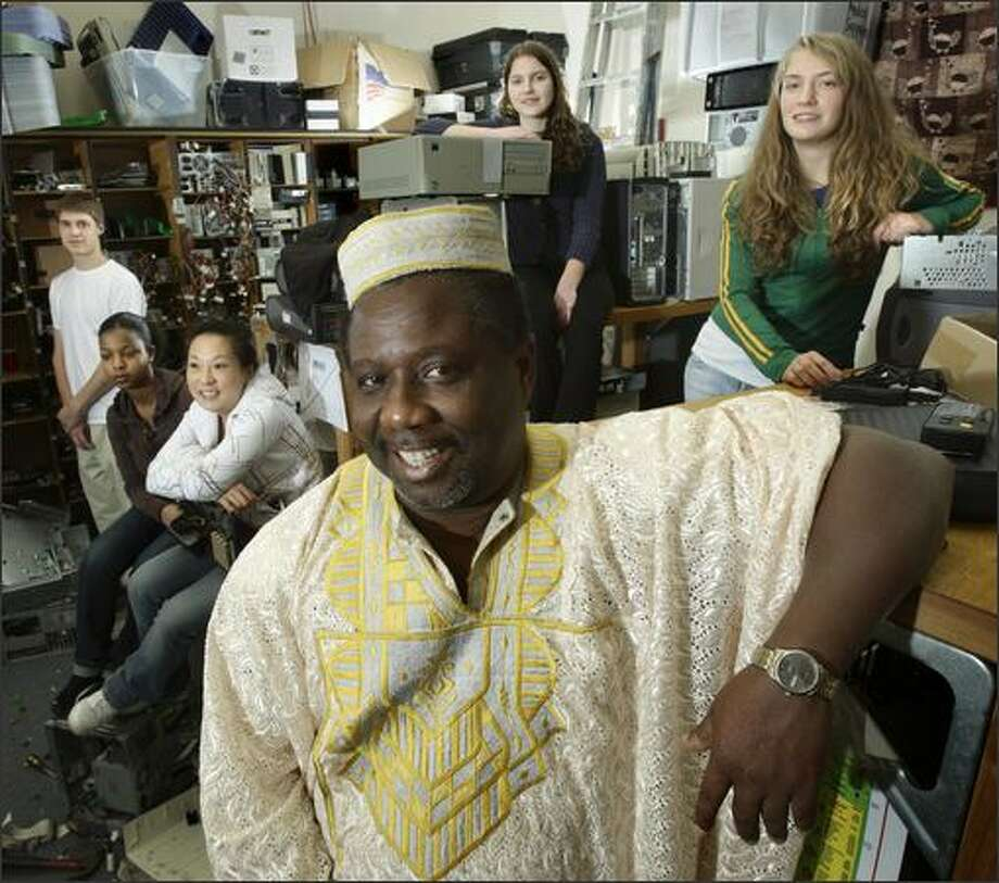 Samuel Labi, a Garfield High School counselor and chief of the Ghanaian village of Kyirenkum, will go to the West African nation next week with students including Kevin Marck, left, Dlena Teklai, Hanah Moriguchi, Caitlin Anderson and Miran McPoland. Photo: Andy Rogers/Seattle Post-Intelligencer