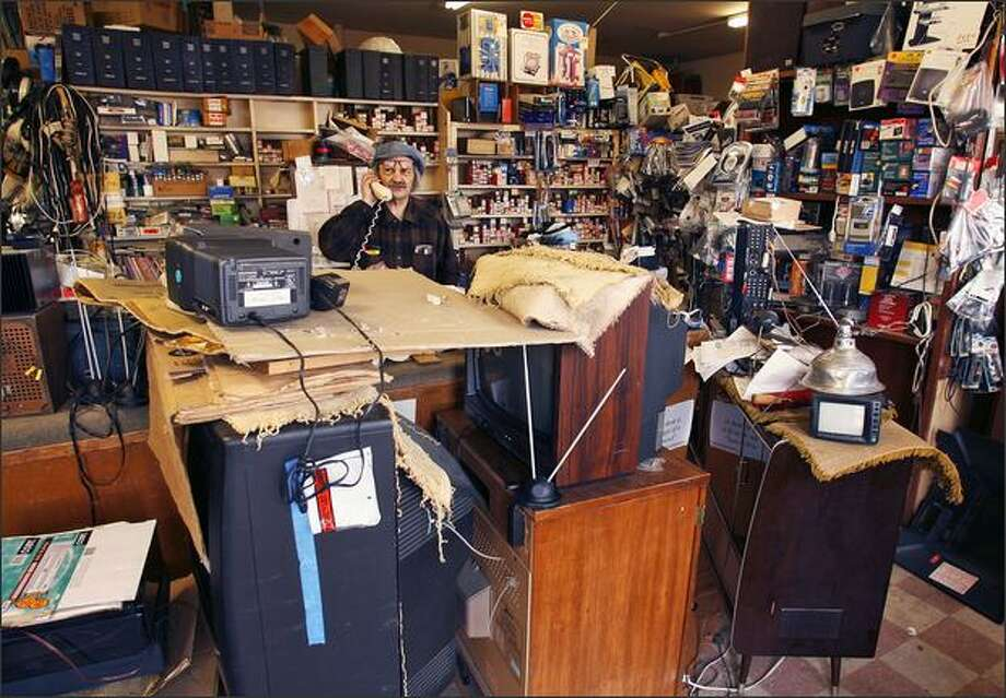 Steve Rubstello, owner of Adams TV, is closing the Fremont television repair shop and making plans to work for someone else for the first time in decades. Photo: Mike Urban/Seattle Post-Intelligencer