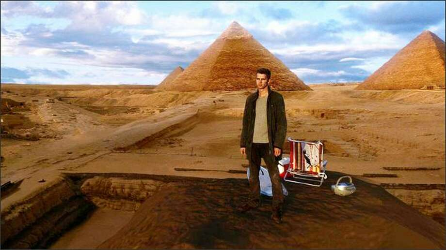 """Hayden Christensen enjoys an impromptu picnic at the Great Pyramids of Egypt in the new motion picture """"Jumper."""" Photo: / Twentieth Century Fox"""