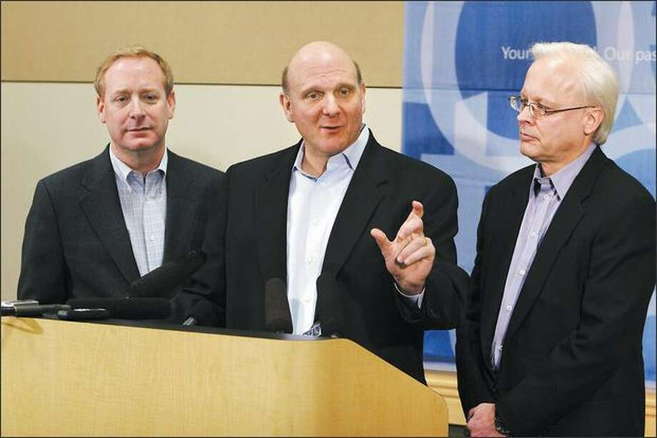 Microsoft Chief Executive Officer Steve Ballmer, center, General Counsel Brad Smith, left, and Chief software architect Ray Ozzie, answer questions during a press conference on February 21, 2008 at Microsoft's Redmond, Wash. campus, about their announcement to make strategic changes in their practices to expand interoperability. Photo: Meryl Schenker/Seattle Post-Intelligencer