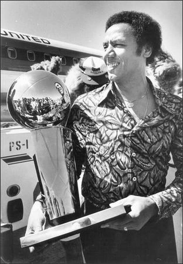 1979: Seattle Supersonics Lenny Wilkens holds the NBA Championship trophy. Photo: Seattle Post-Intelligencer