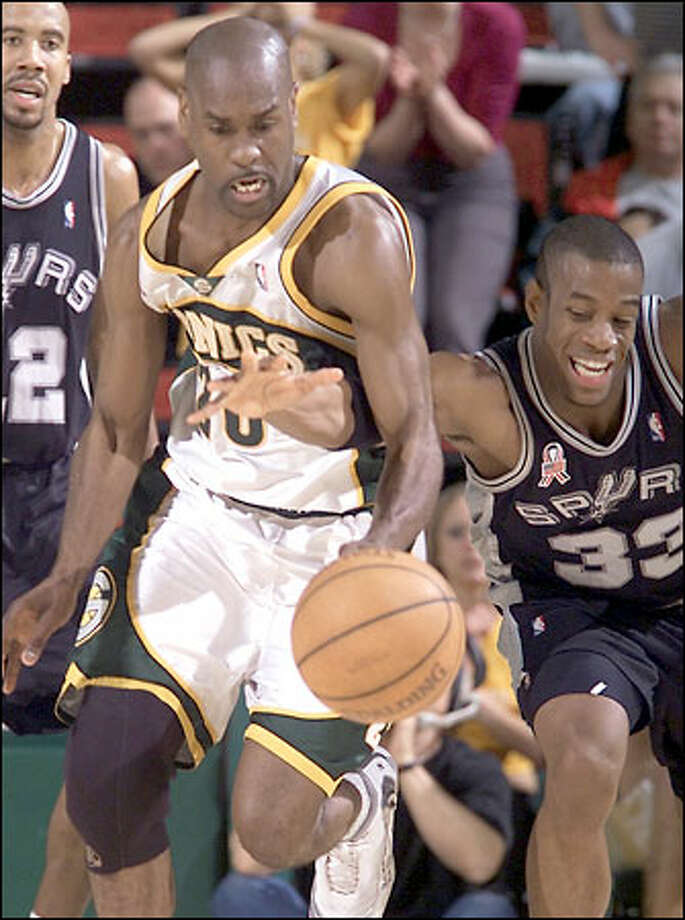 Gary Payton steals the ball from San Antonio's Antonio Daniels (33) during fourth quarter play in the 2002 Playoffs against the Spurs. Photo: Dan DeLong, Seattle Post-Intelligencer