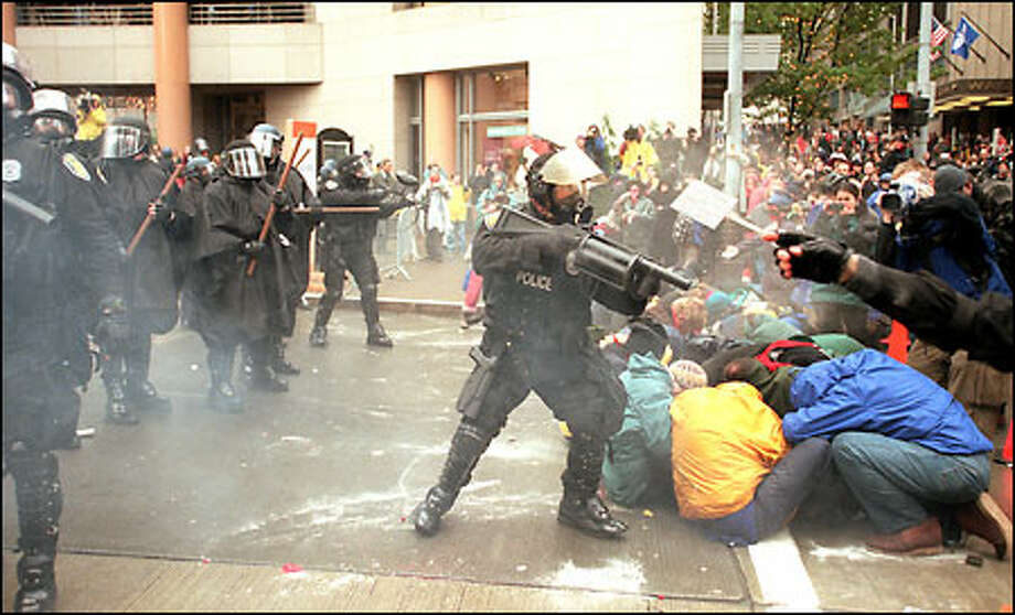 "The end of Seattle civility, 1999: Protests by thousands of people against the World Trade Organization's ministerial conference in late November and early December of 1999 brought police out in force; hundreds were arrested, and clouds of tear gas floated in front of businesses as delegates and officials attending the conference fought to gain access to their own meetings. In the aftermath of WTO, Mayor Paul Schell vowed to ""personally destroy"" a local sheriff, and the human rights group, Amnesty International, said the use of force by police should be independently investigated. Seattle's police chief, Norm Stamper, announced his resignation soon afterward. Photo: Paul Joseph Brown, Seattle Post-Intelligencer"