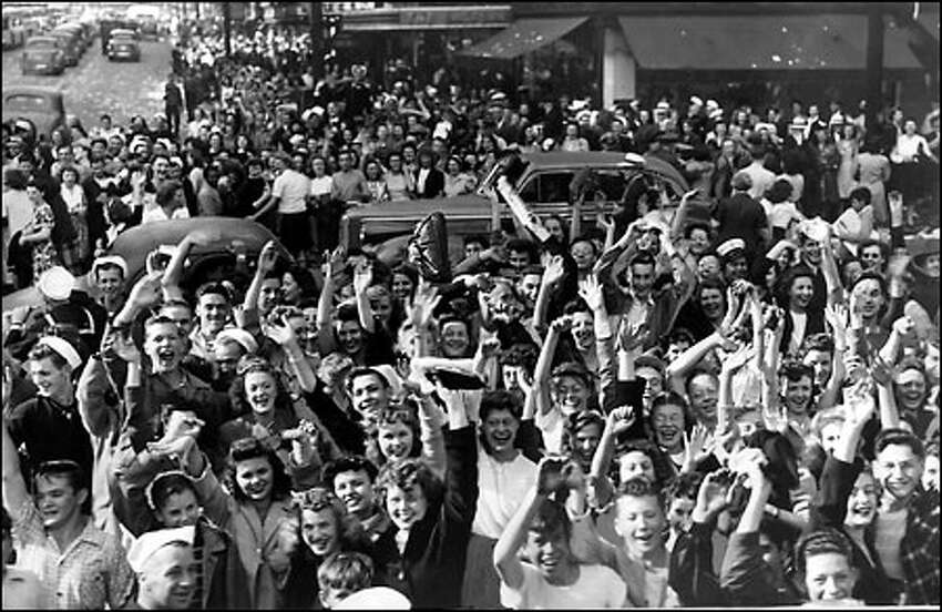 Wild celebration as World War II ends, August 1945: Servicemen and civilians overflow sidewalks and jam the street at Third Avenue and Pike Street on Aug. 14, 1945, as official peace is declared by President Truman. V-J Day is celebrated as Aug. 15, although Japan's surrender was formally signed Sept. 2, 1945.