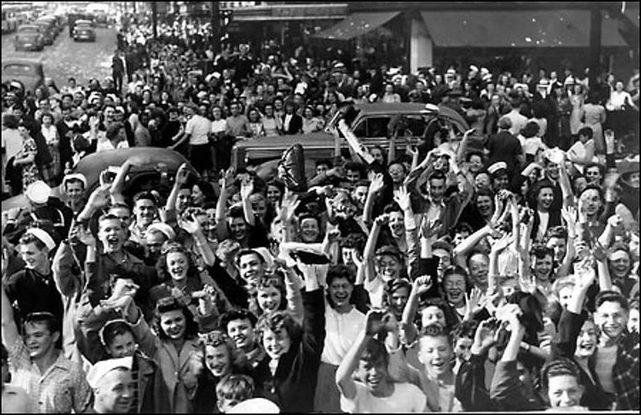 Wild celebration as World War II ends, August 1945: Servicemen and civilians overflow sidewalks and jam the street at Third Avenue and Pike Street on Aug. 14, 1945, as official peace is declared by President Truman. V-J Day is celebrated as Aug. 15, although Japan's surrender was formally signed Sept. 2, 1945. Photo: Seattle Post-Intelligencer
