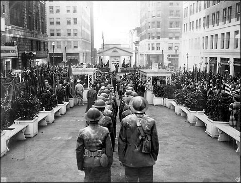 Victory Square, constructed in 1942 on University Street between Fourth and Fifth avenues, became the city's center for public rallies, bond drives and memorial services during World War II. The speaker's stand, in background at center, was shaped like Thomas Jefferson's home, Monticello. Photo: Seattle Post-Intelligencer