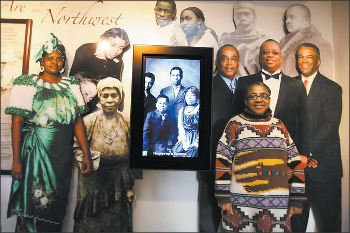 Barbara Earl Thomas, right, curator of the new Northwest African American Museum, stands with cutouts of politicians Norm Rice, Larry Gossett and Ron Sims.