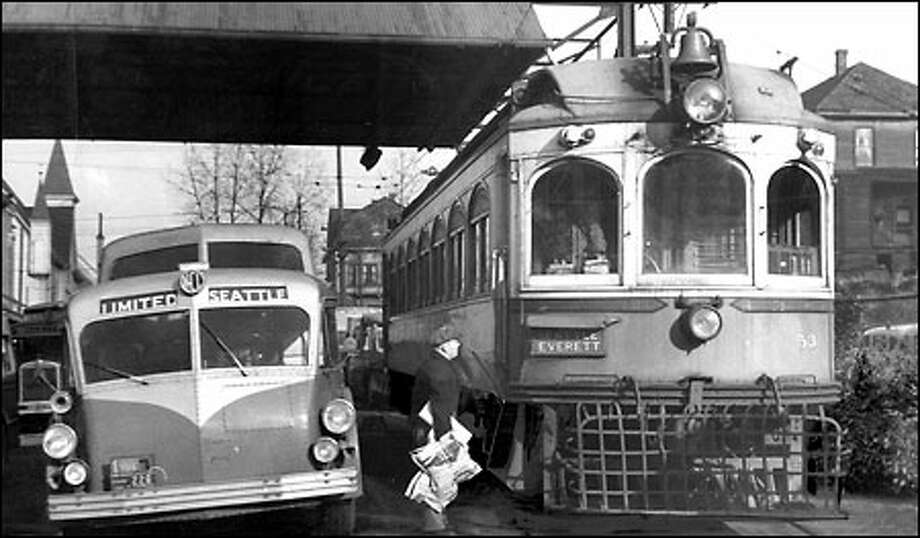 Seattle's Interurban, 1939: The Interurban streetcar, at right, connected Seattle with Everett for about 30 years and carried up to 150 riders on half-hourly runs, at speeds up to 60 mph. The streetcar made its last trip Feb. 21, 1939. Built in an era when roads were poor or non-existent, it was a victim of competition from autos and buses. Photo: Seattle Post-Intelligencer