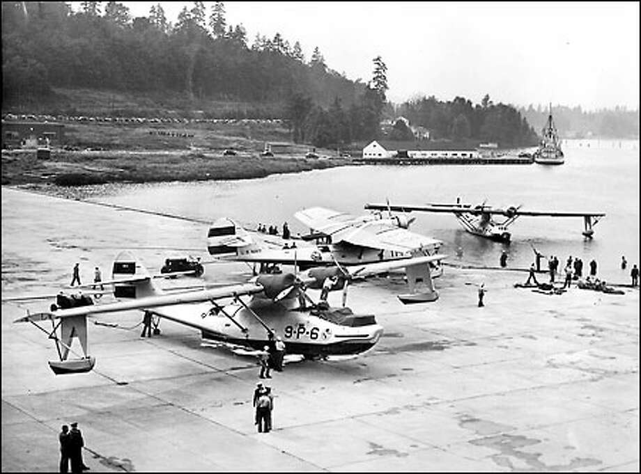 "Air power on display, 1938: Three twin-engine bombers that participated in the Navy's ""greatest mass distance"" flight are seen here just after they landed at the Sand Point Naval Air Station. The planes, commanded by Rear Adm. Charles Blakely, made the flight from San Diego, Calif., in 11 hours and 30 minutes. Photo: Seattle Post-Intelligencer"