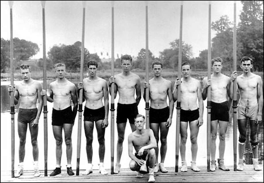 Legendary Husky crew wins Olympic gold, 1936: Representing the United States, UW Husky oarsmen won the gold medal at Berlin, defeating Italy and Germany. The Husky oarsmen were, from left to right, Don Hume, stroke; Joe Rantz, #7 oar; George Hunt, #6; Jim McMillan, #5; John White, #4; Gordon Adam, #3; Charles Day, #2; Roger Morris, bow oar. Kneeling is Bob Moch, coxswain. The coach was Al Ulbrickson. Photo: Seattle Post-Intelligencer