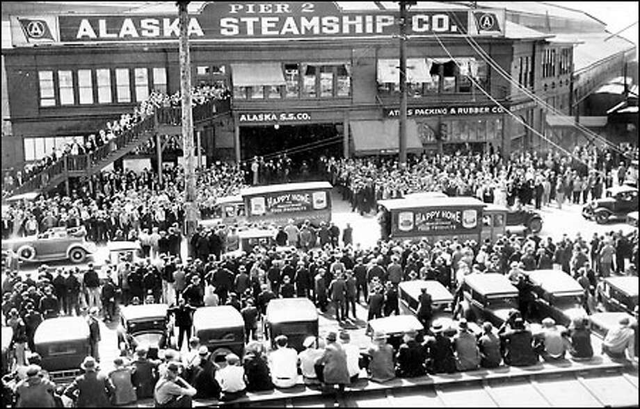 General strike by maritime workers, 1934: Seattle longshoremen and sympathizers block entry to the Alaska Steamship Co.'s Pier 2 on May 9, 1934, during an 84-day general strike by West Coast maritime workers. Police took no action here, although clashes elsewhere resulted in injuries and one striker's death. Photo: Seattle Post-Intelligencer