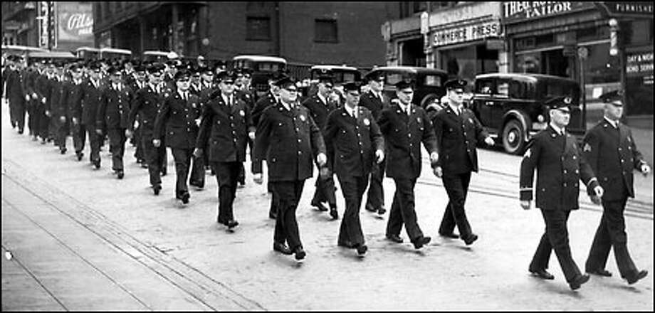 Seattle's finest, 1935: Orders came from new Seattle police Chief George Howard in 1935 to all police officers: coats buttoned, hats straightened and parades formed three times each day at shift change. On behalf of the city's new mayor, Charles L. Smith, Howard also asked for heavier enforcement of traffic regulations and anti-vice laws. Photo: Seattle Post-Intelligencer