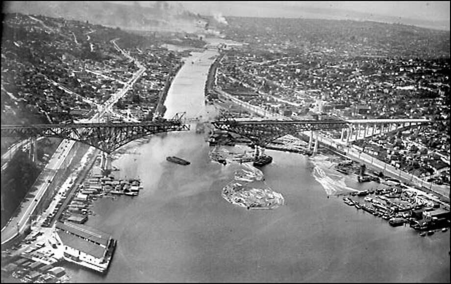 George Washington Memorial Bridge, 1930: Also known as the Aurora Bridge, this famous span was built as part of the original Aurora Highway that ran from Canada to Mexico and later became part of the federal highway system. The 167-foot-high bridge was dedicated Feb. 27, 1932, in observance of George Washington's 200th birthday. Photo: Seattle Post-Intelligencer