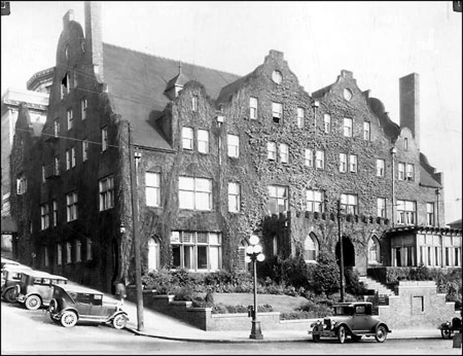 A gentlemen's club, 1927: The Rainier Club, shown here in 1927, was founded in 1888 and moved to its current location at 820 Fourth Ave. in 1904. It became Seattle's gentlemen's club, where civic leaders could engage in conversation and enjoy a meal. Photo: Seattle Post-Intelligencer
