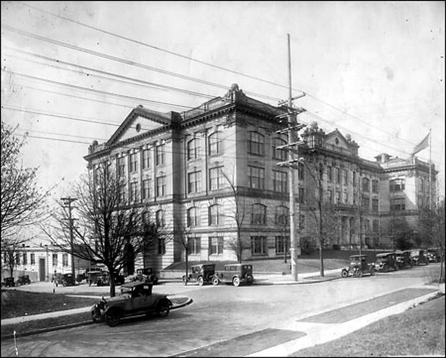 Queen Anne High School, 1920s: Shown here in the 1920s, Queen Anne High was built in 1909 and became one of Seattle's major high schools until it was closed in 1981. When the school was proposed there was considerable opposition from citizens who thought it should be located in the Denny Regrade area. After it closed, the school was converted to condominiums. Photo: Seattle Post-Intelligencer