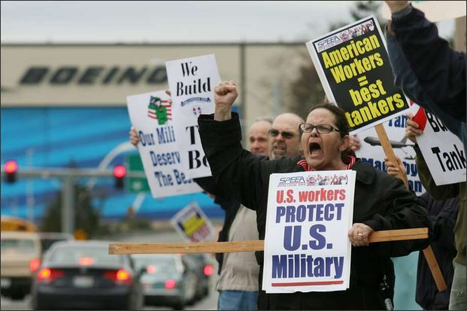 Aerospace workers, including Sandy Hastings, right, a lab technician for SPEEA, protest after the announcement that the U.S. Air Force chose Northrop Grumman Corp. and Airbus parent EADS over Boeing to supply air-refueling tankers. The protest took place outside the Machinists union hall in Everett. Photo: Dan DeLong/Seattle Post-Intelligencer